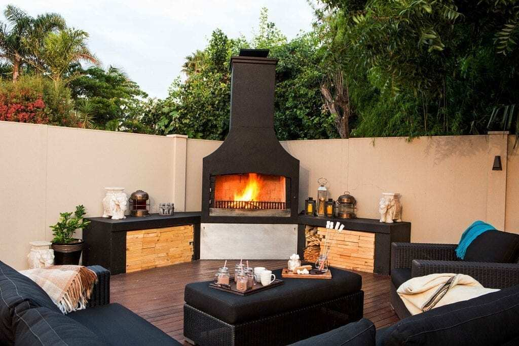 A beautiful entertainment area with a stunning Outdoor Fire