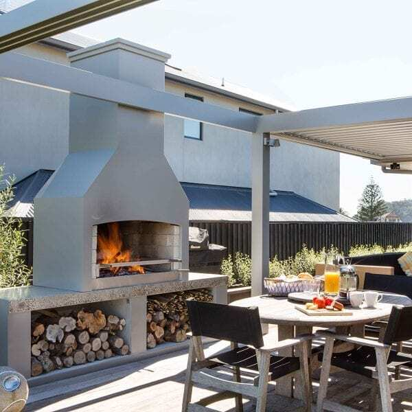 Dine while enjoying the warmth of an outdoor fire