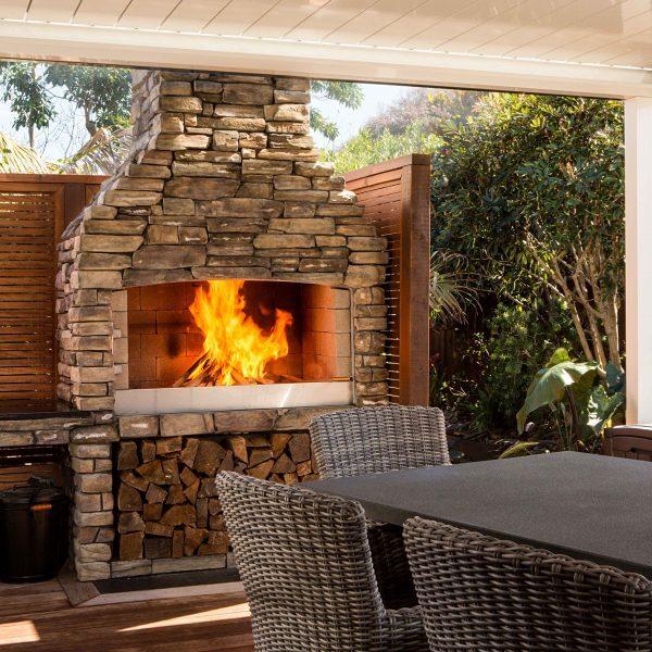 Beautiful backyard garden with a Flare Outdoor Fireplace