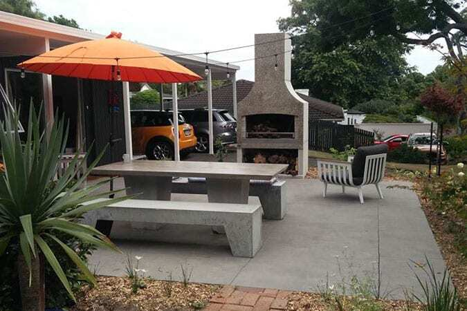 A perfect dining spot in the backyard in front of a Flare Deluxe Outdoor fire