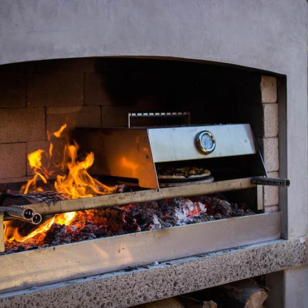Cooking pizza in the Outdoor Fireplace