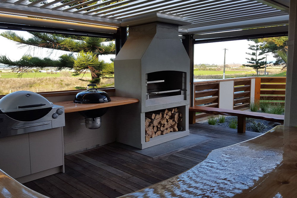 A backyard outdoor place to enjoy the warmth of a Flare Deluxe outdoor fire