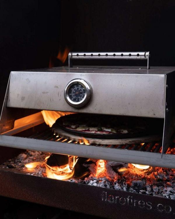 Cooking pizza on a Flare Martello Outdoor Fireplace
