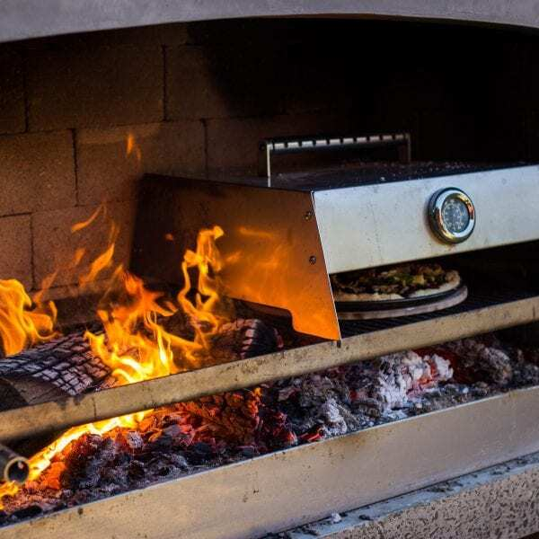 Cooking pizza with cooking accessories on Flare Outdoor Fire