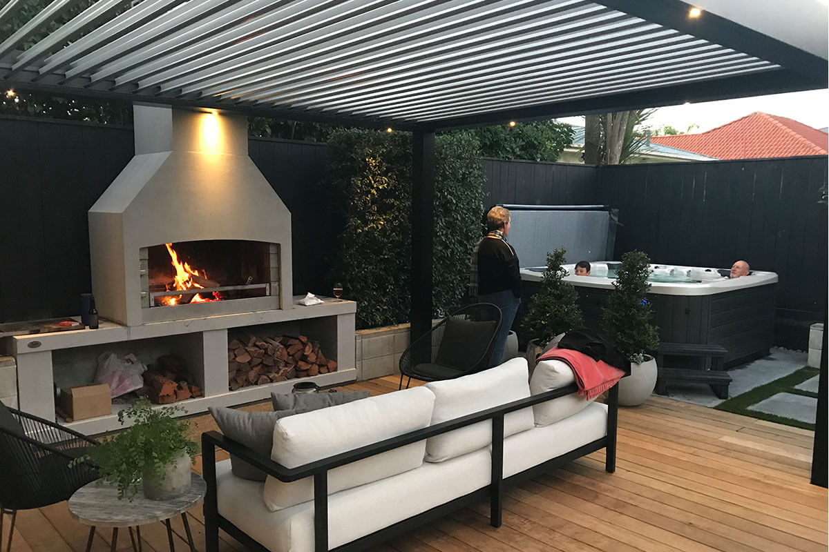 Family enjoying in Entertainment area with an Flare premier fireplace