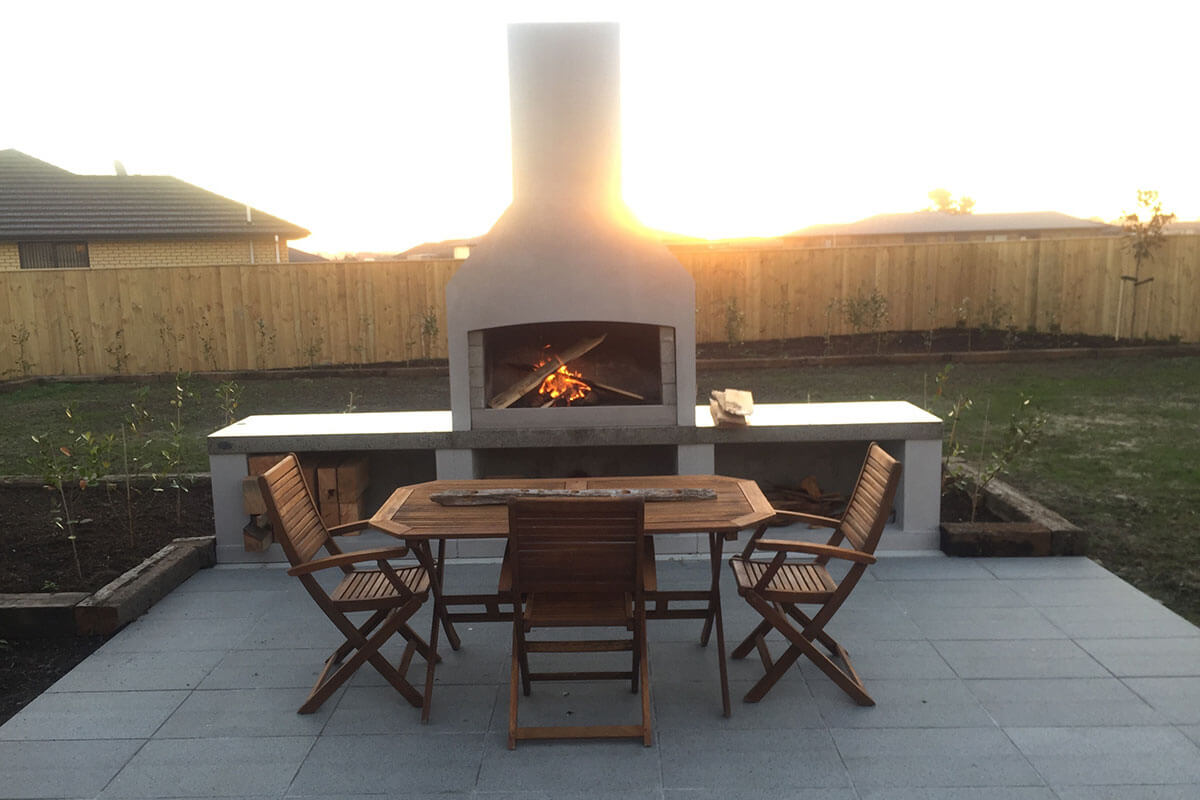 Beautiful outdoor space with a Flare Senator Outdoor Fire.