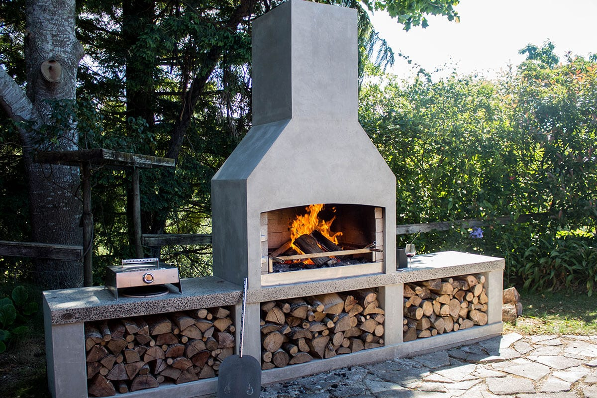 Beautiful Flare Senator Outdoor Fire with pizza hood kit.