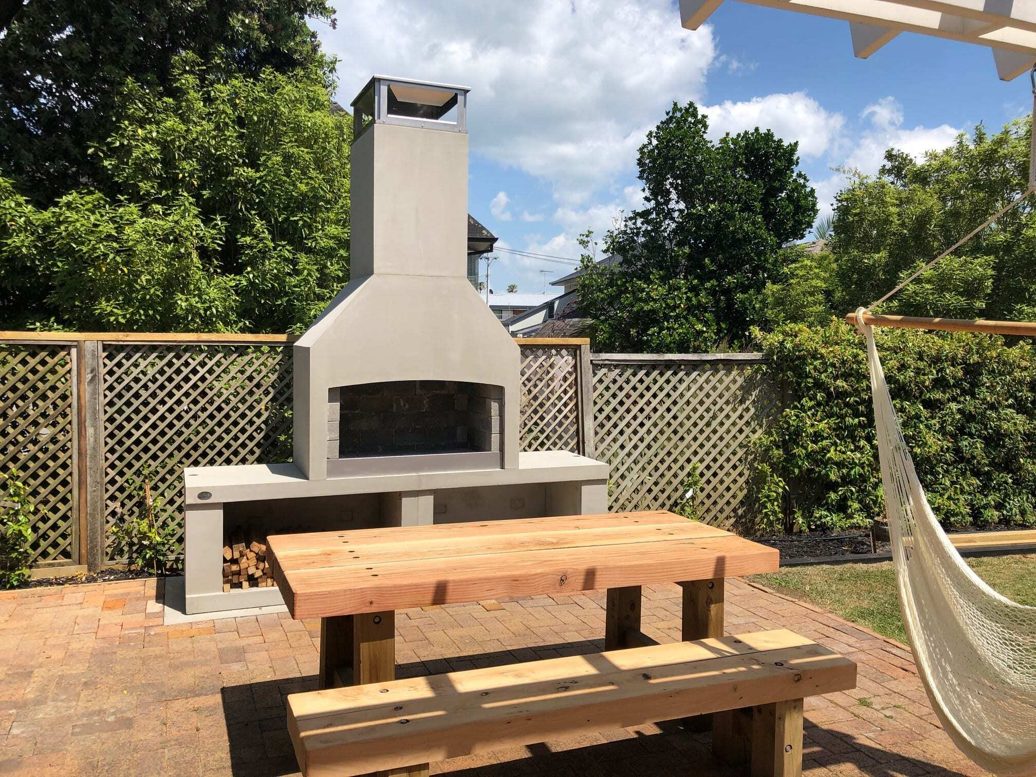 A perfect picnic spot in the backyard in front of a Flare Premier Outdoor fire