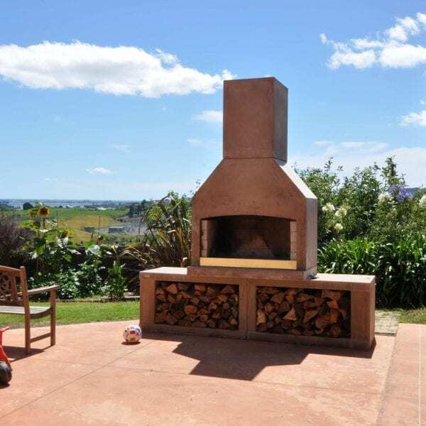 Backyard with an Outdoor fireplace and a scenic backdrop.