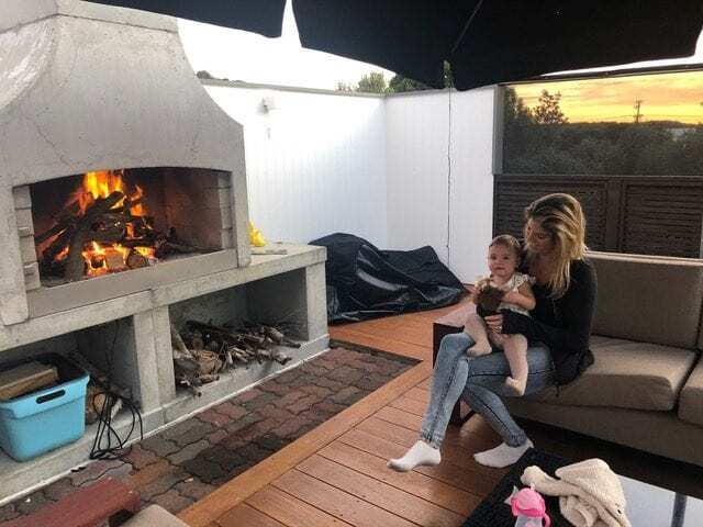 Baby and Mom enjoying the warmth of Flare Outdoor Fire