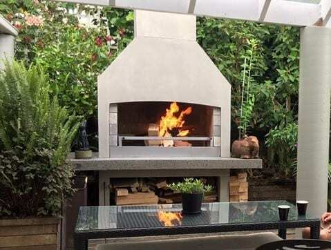 Beautiful backyard garden with Flare Outdoor Fireplace