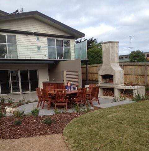 Outdoor fireplace makes backyards better