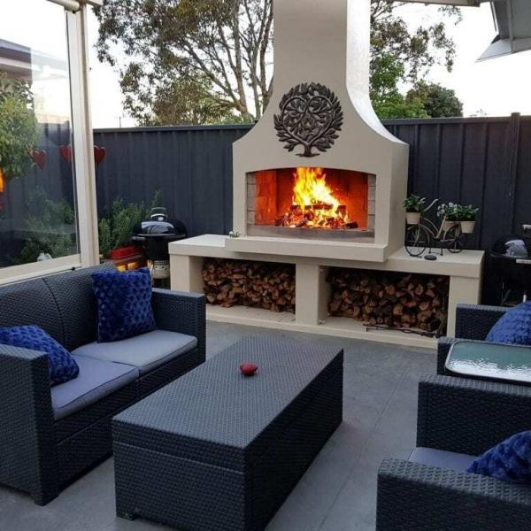 A stunning backyard place with a beautiful outdoor fire to hangout with friends or family
