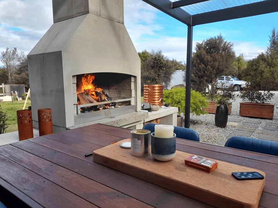 A beautiful backyard with a woodburning Fireplace