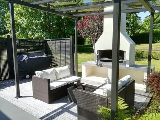 Outdoor place with a fireplace in the backyard garden.